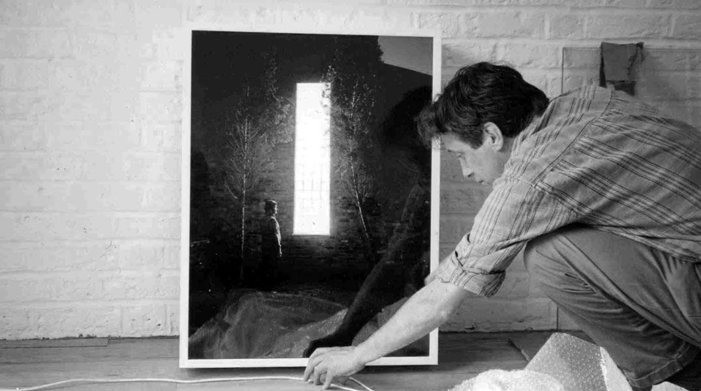 Artist installing lightbox