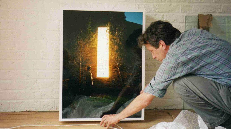 Frank Watson installing lightbox